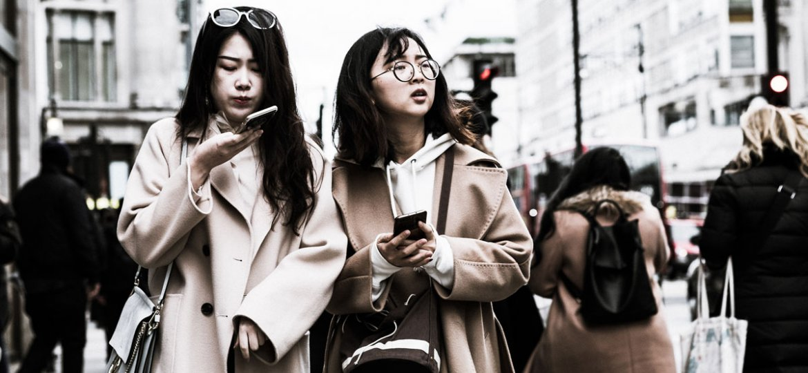 Consumers walking and using smart phones