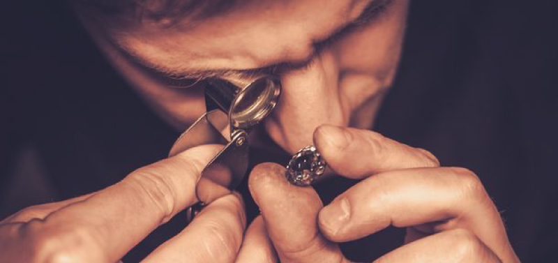 Jeweler Using Loupe