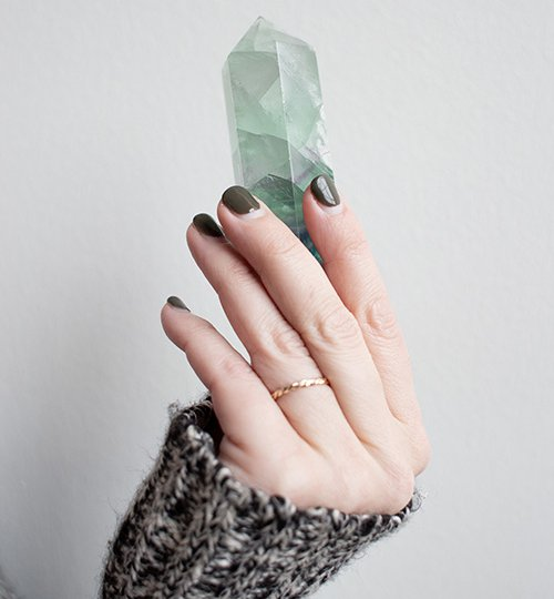 Woman Holding Crystal